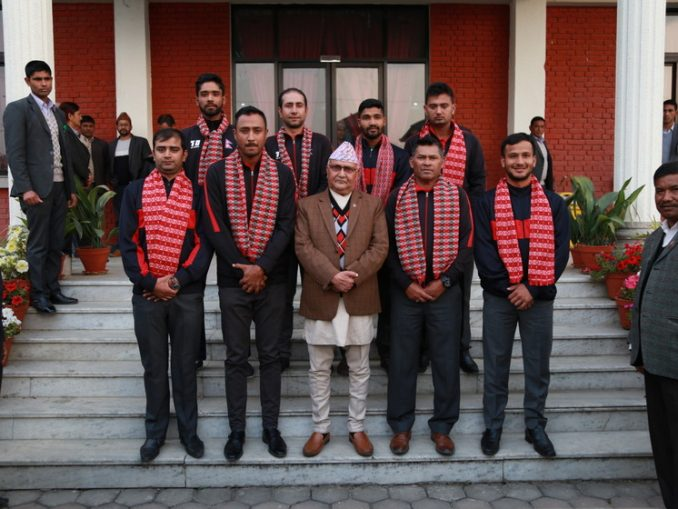 cricket team with pm oli