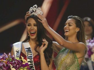 Catriona Gray of the Philippines, left, reacts as she is crowned the new Miss Universe 2018 by Miss Universe 2017 Demi-Leigh Nel-Peters during the final round of the 67th Miss Universe competition in Bangkok, Thailand, Monday, Dec. 17, 2018.(AP Photo/Gemunu Amarasinghe)